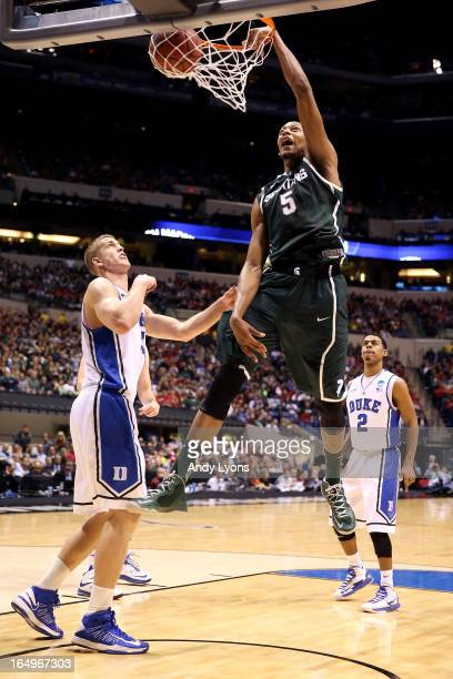 Adreian Payne of the Michigan State Spartans dunks in the first half against Mason Plumlee of the Duke Blue Devils during the Midwest Region...