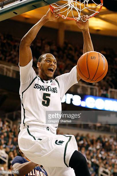 Adreian Payne of the Michigan State Spartans gets in for a first half dunk while playing the Illinois Fighting Illini at the Jack T. Breslin Student...