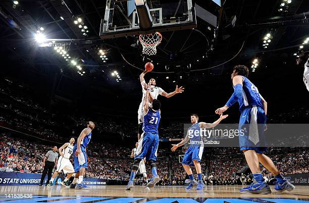 Adreian Payne of the Michigan State Spartans goes up for a dunk against Dwayne Evans of the St Louis Billikens in the first half during the third...