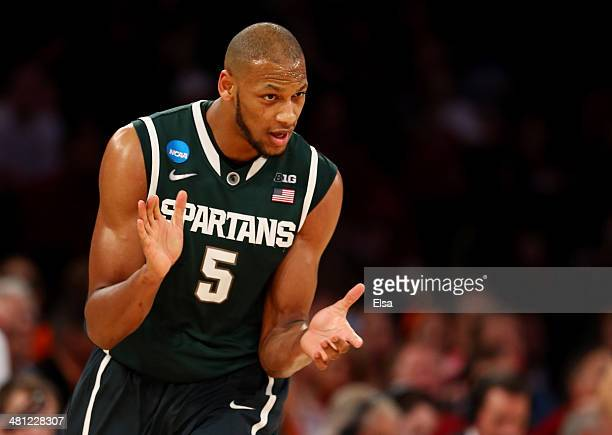 Adreian Payne of the Michigan State Spartans reacts after a basket against the Iowa State Cyclones during the regional semifinal of the 2014 NCAA...