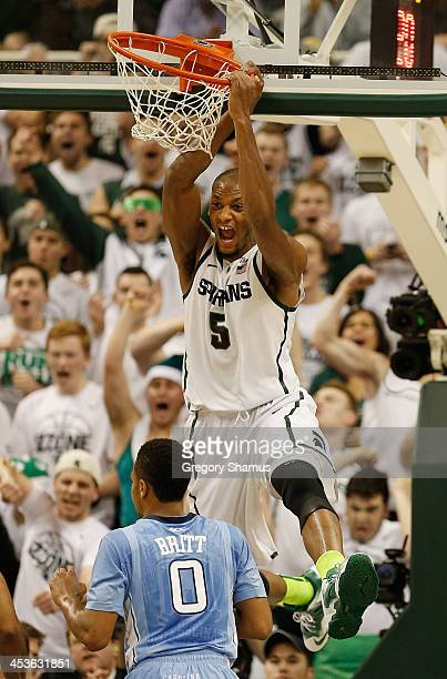 Adreian Payne of the Michigan State Spartans reacts after a first half dunk behind Nate Britt of the North Carolina Tar Heels at the Jack T Breslin...