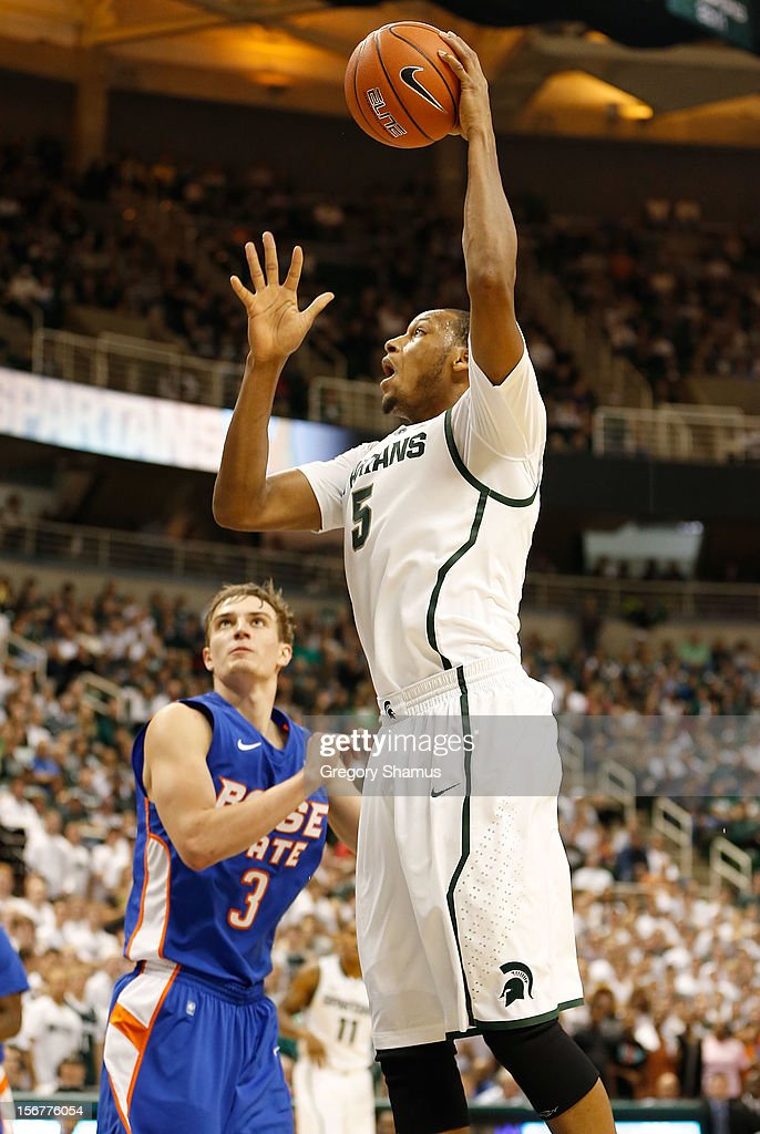 Adreian Payne #5 of the Michigan State Spartans takes a shot over Anthony Drmic #3 of the Boise State Broncos at the Breslin Center on November 20, 2012 in East Lansing, Michigan. Michigan State won the game 74-70.