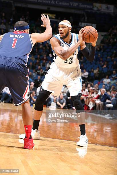 Adreian Payne of the Minnesota Timberwolves handles the ball against Jared Dudley of the Washington Wizards on March 2 2016 at Target Center in...
