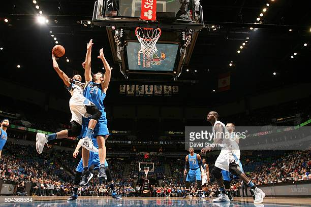 Adreian Payne of the Minnesota Timberwolves shoots the ball against the Dallas Mavericks on January 10 2016 at Target Center in Minneapolis Minnesota...