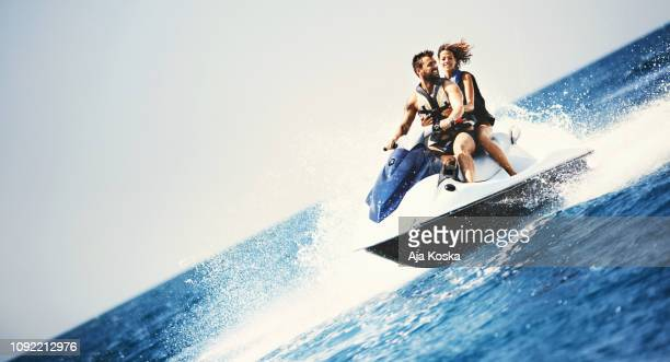adrenaline junkies. - jet ski stock pictures, royalty-free photos & images