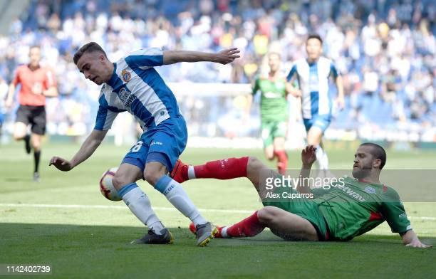 Adria Pedrosa of RCD Espanyol escapes a challenge of Victor Laguardia of Deportivo Alaves and goes onto to score his sides first goal during the La...