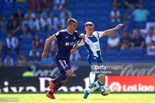 Adria Pedrosa of RCD Espanyol fights for the ball with Sergi Guardiola of Real Valladolid CF during the Liga match between RCD Espanyol and Real...