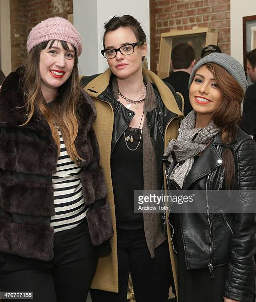 Adria Petty Kelley Reynolds and Veronica Gutierrez attend Avant Gallery New York City preview opening event at Avant Gallery on March 4 2014 in New...