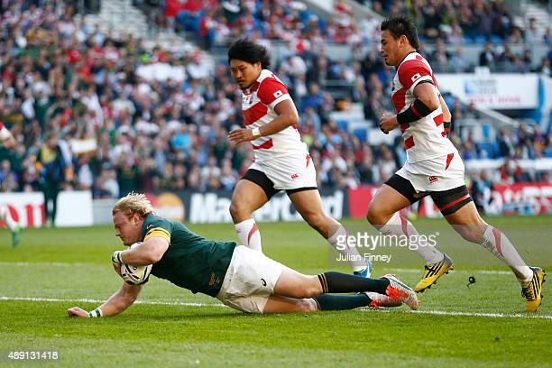 Adriaan Strauss of South Africa dives over the score his side's fourth try during the 2015 Rugby World Cup Pool B match between South Africa and...