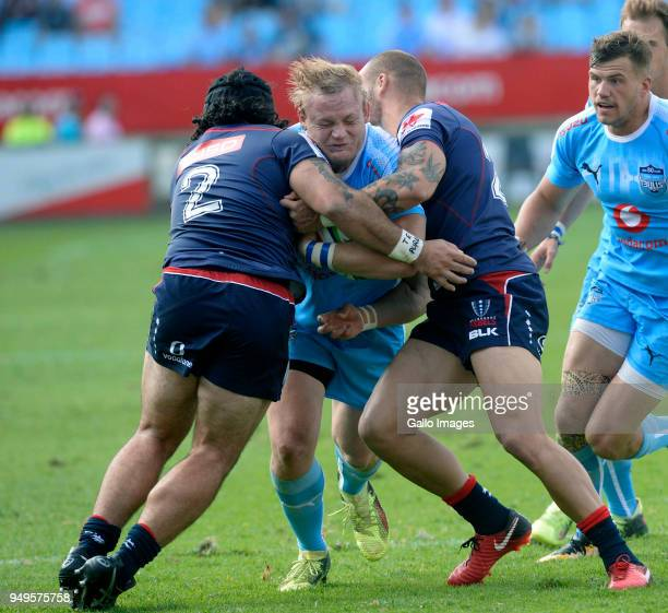 Adriaan Strauss of the Bulls tackled by Anaru Rangi of the Rebels during the Super Rugby match between Vodacom Bulls and Rebels at Loftus Versfeld on...