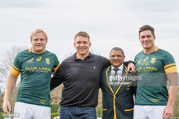 Adriaan Strauss of the Springboks former Springbok captain John Smit Springbok Head Coach Allister Coetzee and Francois Louw of the Springboks pose...