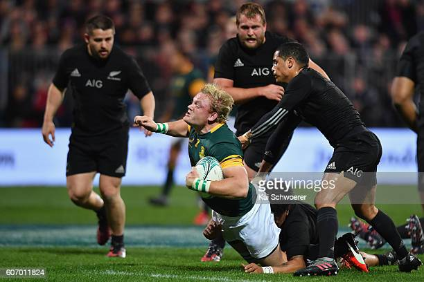 Adriaan Strauss of the Springboks is tackled by Ardie Savea of the All Blacks during the Rugby Championship match between the New Zealand All Blacks...
