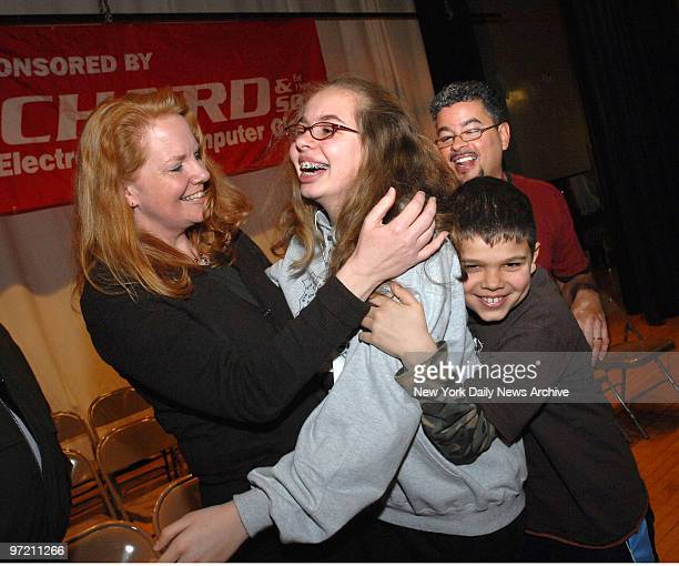 Adrian Acevedo is congratulated by her mom Melanie brother David and dad Johnny after winning the annual Daily News New York Citywide Spelling Bee at...