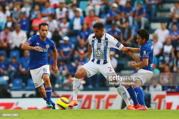 Adrian Aldrete and Angel Mena of Cruz Azul struggle for the ball against Franco Jara of Pachuca during the 11th round match between Cruz Azul and...