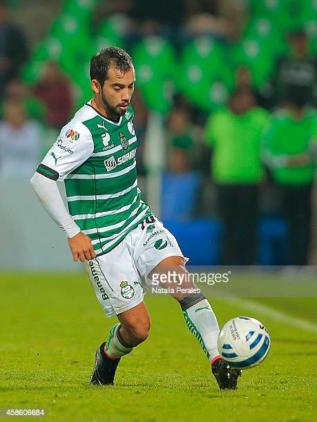 Adrian Aldrete kicks the ball during a match between Santos Laguna and Pachuca as part of 16th round Apertura 2014 Liga MX at Corona Stadium on...
