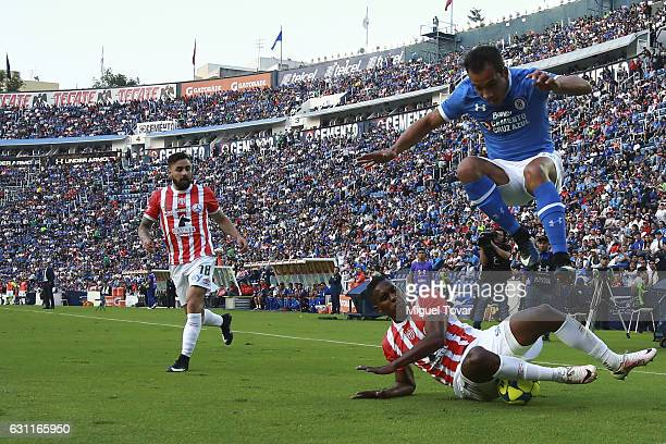Adrian Aldrete of Cruz Azul fights for the ball with Brayan Beckeles of Necaxa during the 1st round match between Cruz Azul and Necaxa as par of the...