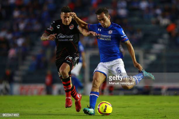 Adrian Aldrete of Cruz Azul struggles for the ball against Juan Iturbide of Tijuana during the first round match between Cruz Azul and Tijuana as...