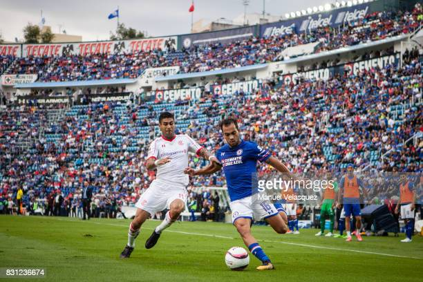 Adrian Aldrete of Cruz Azul struggles for the ball against Rodrigo Lopez of Toluca during the 4th round match between Cruz Azul and Chivas as part of...