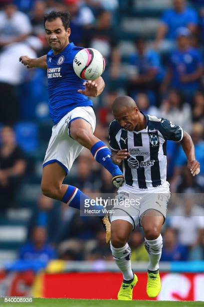 Adrian Aldrete of Cruz Azul struggles for the ball with Carlos Sanchez of Monterrey during the seventh round match between Cruz Azul and Monterrey as...