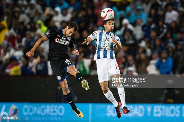 Adrian Aldrete of Cruz Azul struggles for the ball with Jonathan Urretaviscaya of Pachuca during the 11th round match between Pachuca and Cruz Azul...