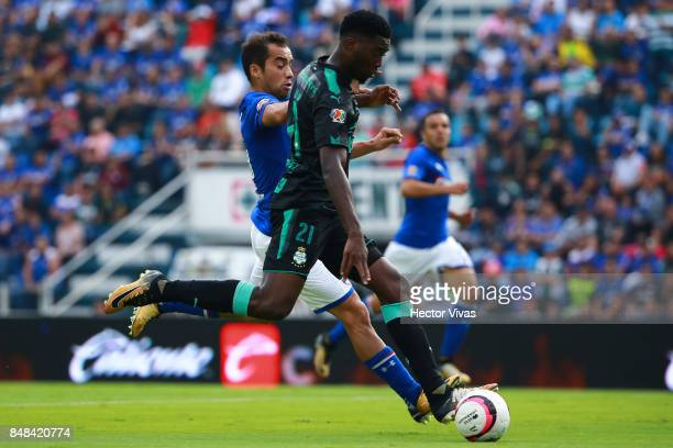 Adrian Aldrete of Cruz Azul struggles for the ball with Jorge Tavares of Santos Laguna during the 9th round match between Cruz Azul and Santos Laguna...