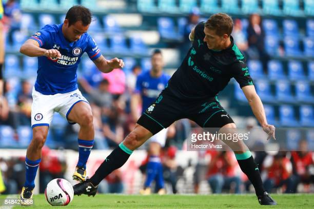 Adrian Aldrete of Cruz Azul struggles for the ball with Julio Furch of Santos Laguna during the 9th round match between Cruz Azul and Santos Laguna...