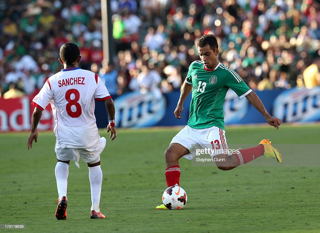 Adrian Aldrete #13 of Mexico passes the ball past Marcos Sanchez #8 of Panama during the first round of the 2013 CONCACAF Gold Cup at the Rose Bowl on July 7, 2013 in Pasadena, California. Panama won 2-1.