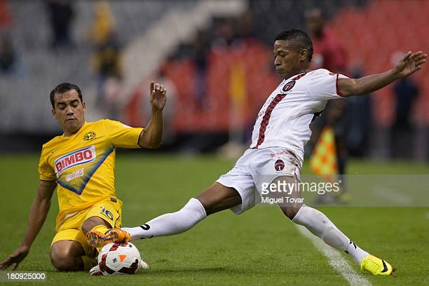 Adrian Aldrete of Mexico's America fights for the ball with Alcibiades Rojas of Panama's Sporting San Miguelito during a match between America and...