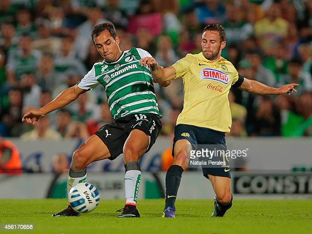 Adrian Aldrete of Santos fights for the ball with Miguel Layun of America during a match between Santos Laguna and America as part of 10th round...