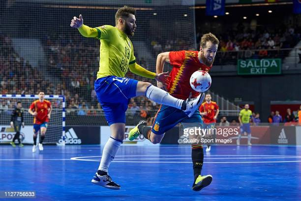 Adrian Alonso of Spain Futsal competes for the ball with Fabrizio Bastecini of Brazil Futsal during the Futsal International friendly match between...