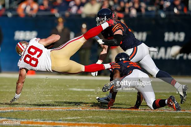Adrian Amos of the Chicago Bears hits Vance McDonald of the San Francisco 49ers at Soldier Field on December 6 2015 in Chicago Illinois