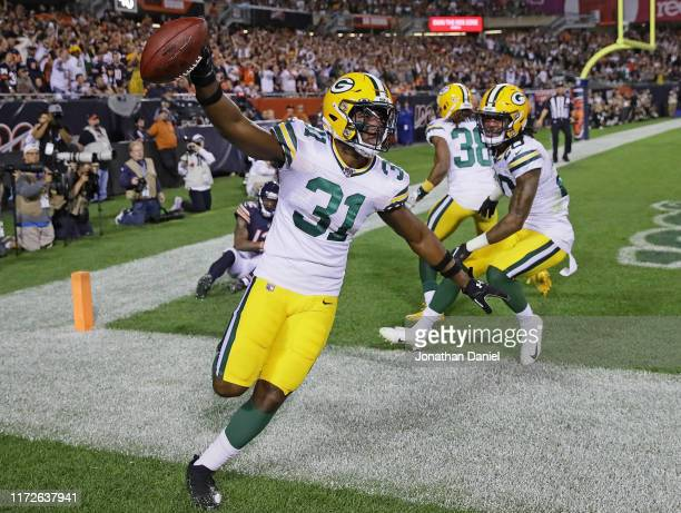 Adrian Amos of the Green Bay Packers celebrates afterintercepting a pass in the end zone over Allen Robinson of the Chicago Bears at Soldier Field on...
