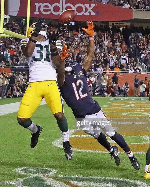Adrian Amos of the Green Bay Packers intercepts a pass in the end zone over Allen Robinson of the Chicago Bears at Soldier Field on September 05,...