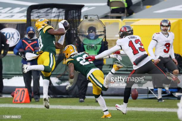Adrian Amos of the Green Bay Packers intercepts a pass intended for Mike Evans of the Tampa Bay Buccaneers in the third quarter during the NFC...