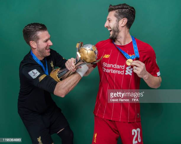 Adrian and Adam Lallana of Liverpool pose with the Club World Cup trophy after the FIFA Club World Cup Qatar 2019 Final match between Liverpool and...