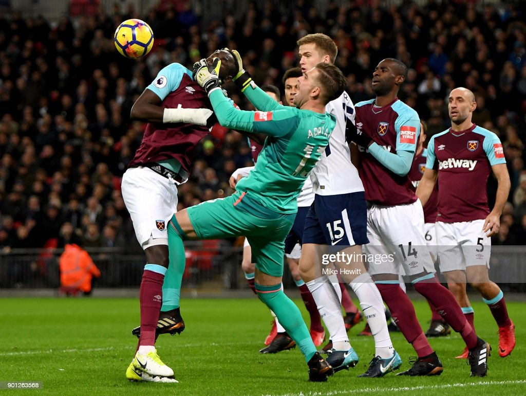 Adrian and Cheikhou Kouyate of West Ham United get in a tangle during the Premier League match between Tottenham Hotspur and West Ham United at Wembley Stadium on January 4, 2018 in London, England.