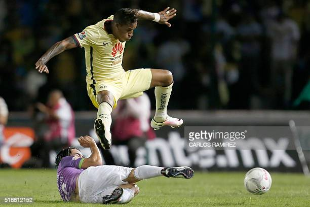 Adrian Andrade of Jaguares vies for the ball with Michael Arroyo of America during their Mexican Clausura tournament football match at the Victor...
