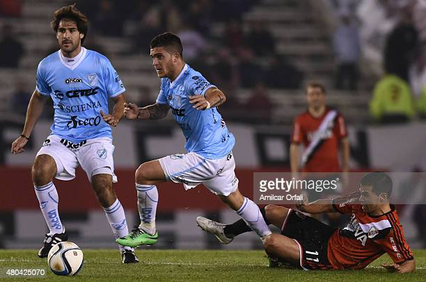 Adrian Arregui of Temperley and Javier Saviola of River Plate fight for the ball during a match between River Plate and Temperley as part of 16th...