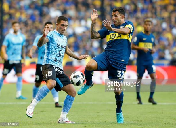 Adrian Arregui of Temperley fights for the ball with Carlos Tevez of Boca Juniors during a match between Boca Juniors and Temperley as part of the...