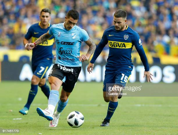 Adrian Arregui of Temperley fights for the ball with Nahitan Nandez of Boca Juniors during a match between Boca Juniors and Temperley as part of the...