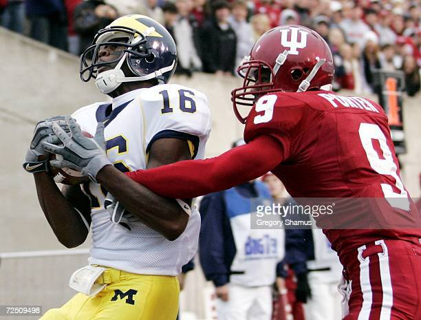 Adrian Arrington of the Michigan Wolverines pulls in a first quater touchdown against Tracy Porter of the Indiana Hoosiers on November 11 2006 at...