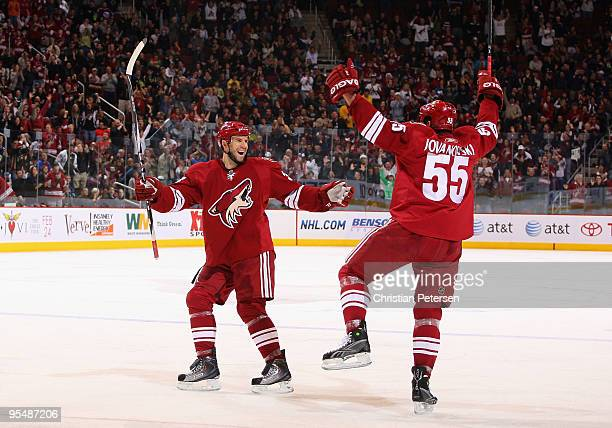 Adrian Aucoin and Ed Jovanovski of the Phoenix Coyotes celebrate after Jovanovski scored a second period power play goal against the Vancouver...