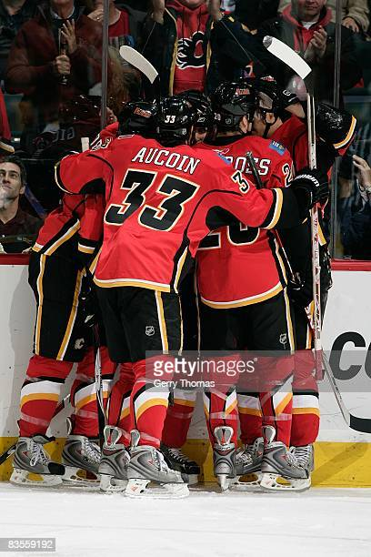 Adrian Aucoin and teammates of the Calgary Flames celebrate a goal against the Boston Bruins on October 30 2008 at Pengrowth Saddledome in Calgary...