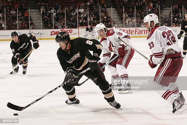 Adrian Aucoin of the Phoenix Coyotes defends against Teemu Selanne of the Anaheim Ducks during the game on November 29, 2009 at Honda Center in...
