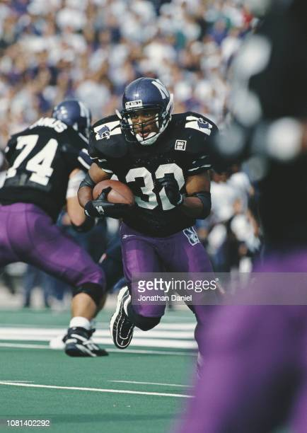 Adrian Autry Running Back for the Northwestern University Wildcats runs the ball during the NCAA Big Ten Conference college football game against the...