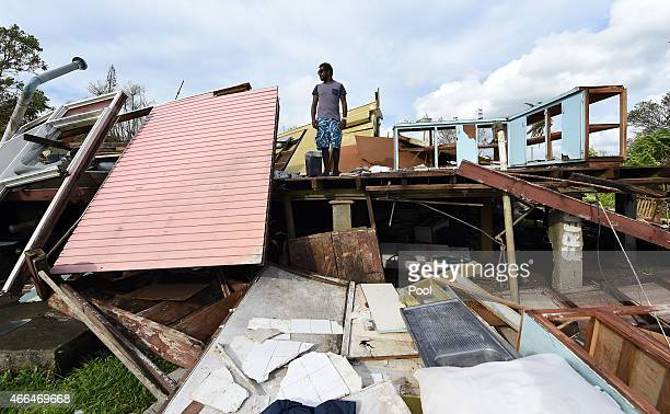Adrian Banga surveys his destroyed house on March 16 2015 in Port Vila Vanuatu Cyclone Pam has hit South Pacific islands on Saturday with hurricane...