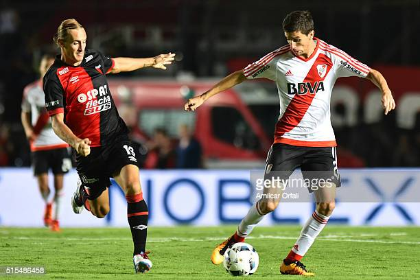 Adrian Bastia of Colon fights for the ball with Ignacio Fernandez of River Plate during a match between Colon and River Plate as part of Torneo de...