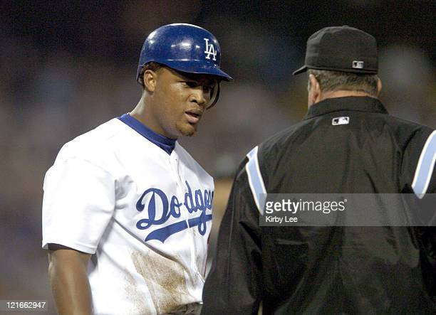 Adrian Belte of the Los Angeles Dodgers argues a call by firstbase umpire Dale Scott during 64 loss to the Florida Marlins at Dodger Stadium in Los...