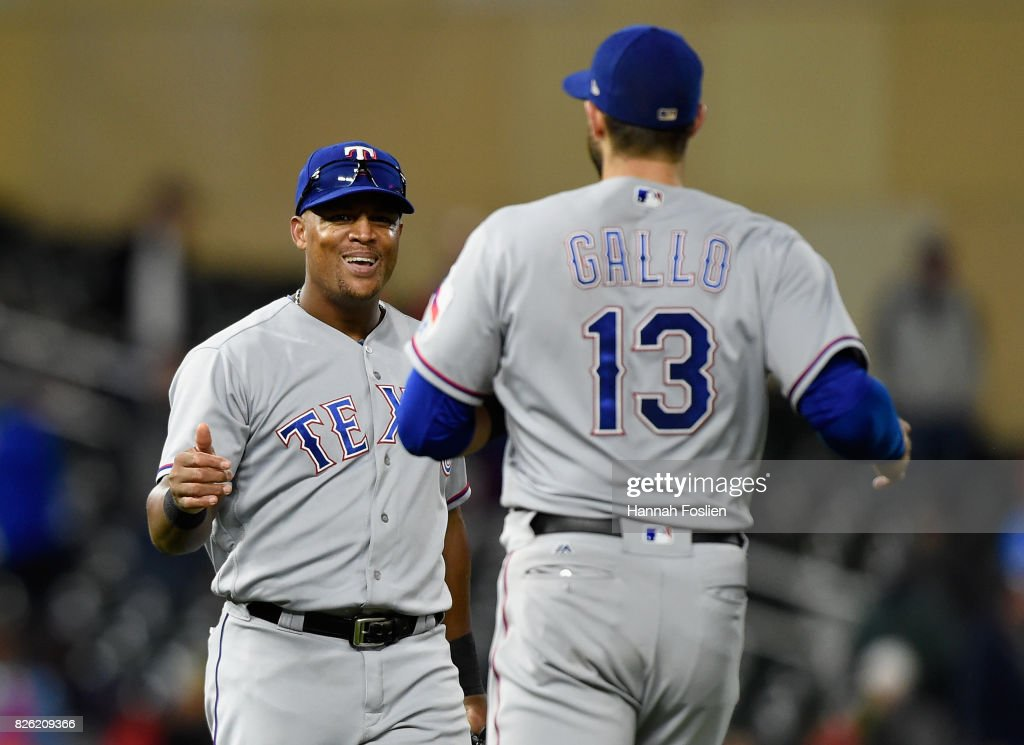Adrian Beltre #29 and Joey Gallo #13 of the Texas Rangers celebrating winning against the Minnesota Twins after the game on August 3, 2017 at Target Field in Minneapolis, Minnesota. The Rangers defeated the Twins 4-1.