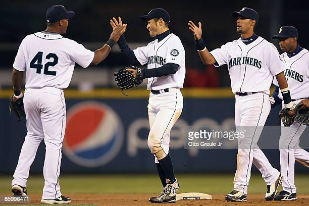 Adrian Beltre Ichiro Suzuki and Franklin Gutierrez of the Seattle Mariners celebrate after defeating the Los Angeles Angels of Anaheim 113 at Safeco...